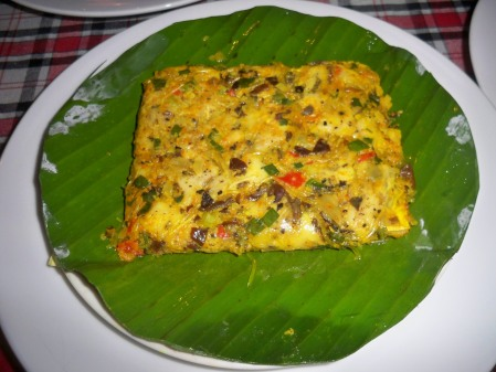 Grilled mackerel in banana leaf
